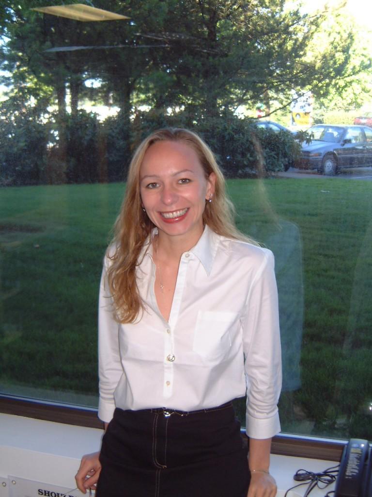 Photo of Natasha Rinard, OTRL leaning against window at SW Clinic