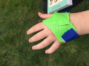 Nick Rinard Physical Therapy Child hand splint green and blue