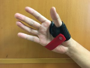 Nick Rinard Physical Therapy red and black thumb splint