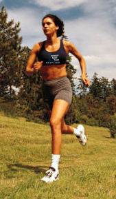 Picture of woman running wearing RinardPT logo