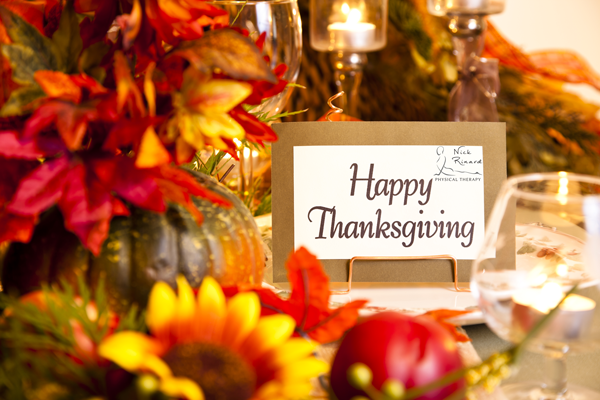 Photo of Fall Colors and Harvest Foods with Card wishing Happy Thanksgiving from Nick Rinard Physical Therapy